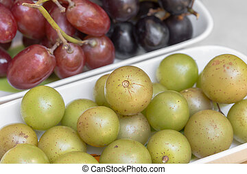 Swamp Grapes - Muscadine swamp grapes with red and black...