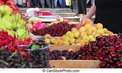 Fruits Market - Showcase Fruits. Woman chooses fruits on...