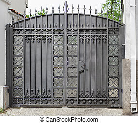 Iron gate - Closed gray iron gate house exterior