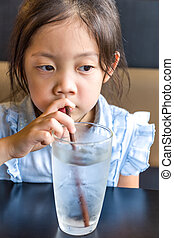 Asian Child Drinking Water from Glass