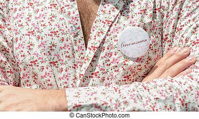 Closeup man in floral shirt.