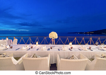 Romantic dinner setup, decoration with candle light....