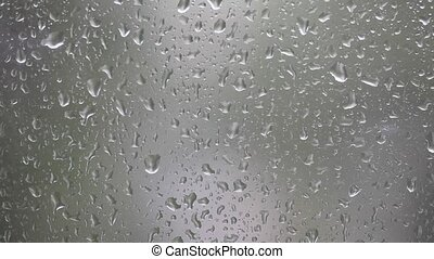 Close-up of water drops - Raindrops running down a window...
