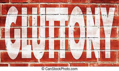 Gluttony On A Brick Wall.