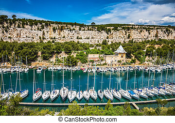 White sailboats moored near the shore - White sailboats...