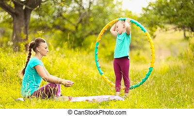 with the child and mother hoop - Mom with a child and a hoop...