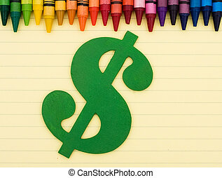 Cost of education - Colorful crayons on a sheet of lined...