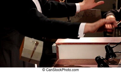 man conducts the orchestra - the hands of a man who conducts...