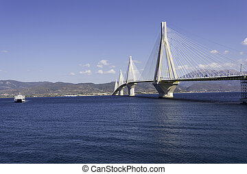 Cable-stayed suspension bridge crossing Corinth Gulf strait,...
