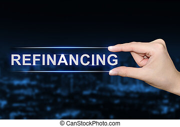 hand clicking refinancing button - hand pushing refinancing...