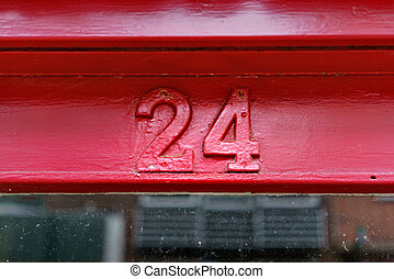 Number 24 - house number twenty four, painted red