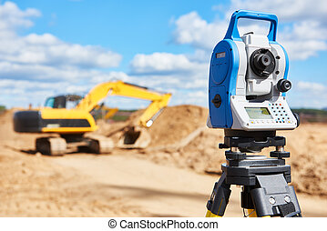 surveyor equipment theodolie at construction site with...