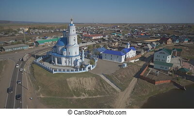 Panoramic view of church standing next to road in middle of...