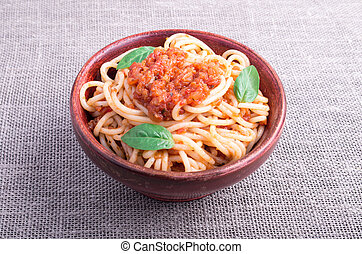 Small portion of cooked spaghetti with tomato relish closeup...