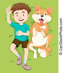 Boy and dog on the grass