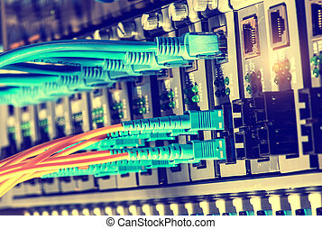 Fiber Optic cables connected to an optic ports and Network...
