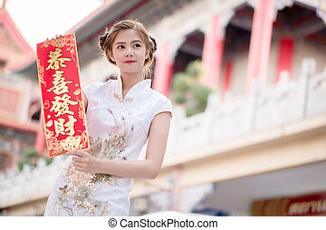 The Asian woman in chinese dress holding couplet Lucrative...
