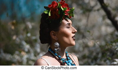 Woman in image of Frida Kahlo pose to photographer