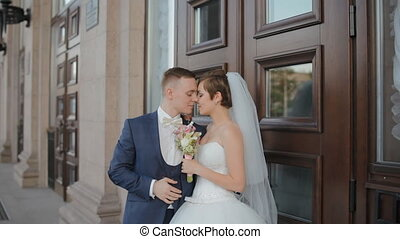 Bride and groom pose to photographer outdoor - Bride and...