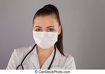 Nurse with ponytail and with white gauze is against grey...