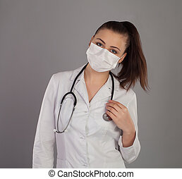 Nurse in gauze is against grey background