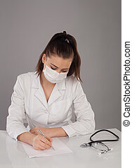 Writting a report - Nurse in white robe is making a report...
