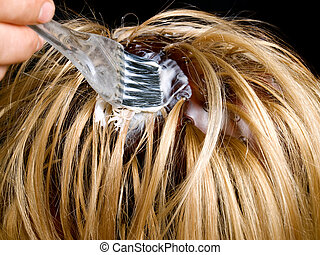 Hair dyeing - Closeup view during hair dyeing treatment ......