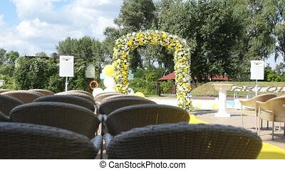Arch with fresh yellow and white flowers for wedding ceremony