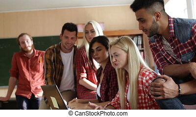 Students using laptop tablet computer people group smile...