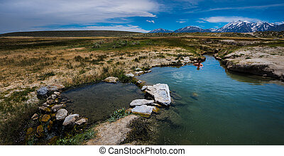 Woman in Mammoth Hor Springs California with Sierras in the...