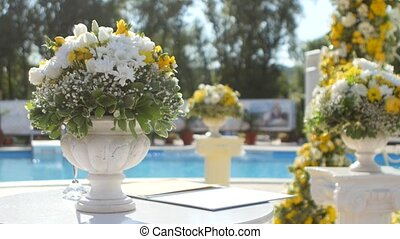 Yellow and white flowers for decor wedding interior - Near...