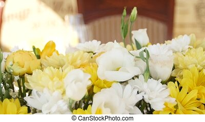 Decoration with fresh yellow and white flowers. Close up