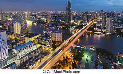Night lights Bangkok city with bridge cross main river,...