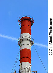Industrial pollution chimney without a smoke on blue sky...