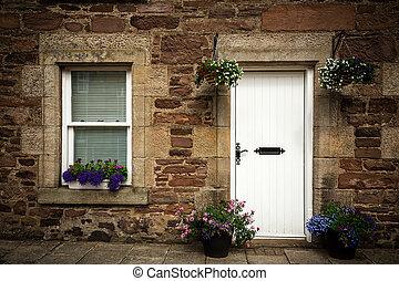 Stone cottage door and window detail. - Door and window...