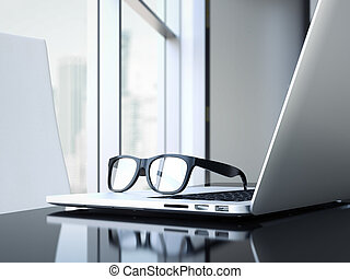 Office desk with laptop and glasses. 3d rendering