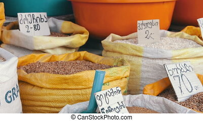 Showcases Grain in Sacks in Georgia. Prices for bags with...