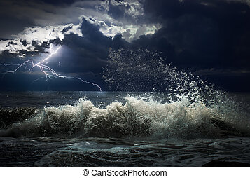dark ocean storm with lgihting and waves at night - dark...