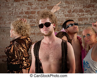 Bare chested man at disco party - Disco pose with friends at...