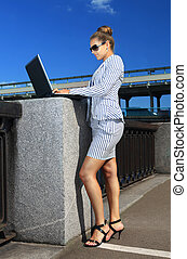 woman in suit with laptop