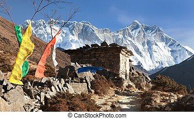 Lhotse, Nuptse and buddhist prayer walls and flags -...