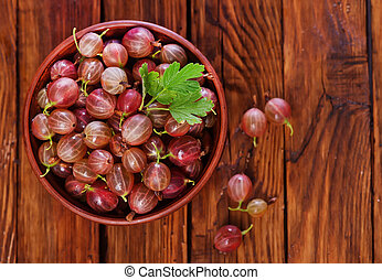 gooseberry in bowl and on a table