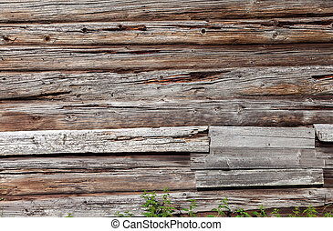 Wooden logs wall of old rural house as background