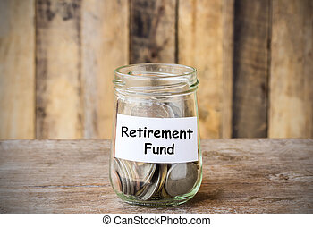 Coins in glass money jar with Retirement fund label
