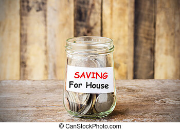 Text for SAVING for house, concept money in the glass