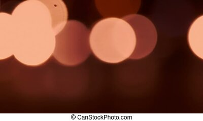 Defocused night traffic lights toned in honey color.