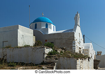 Paros island, Cyclades, Greece - White chuch with blue roof...