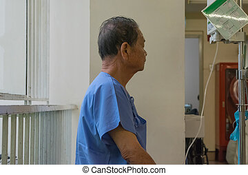Patient waiting a doctor in hospital - Patient elderly...