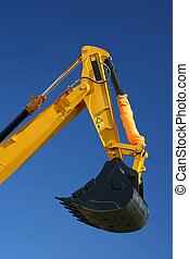 Digging Machine - Black digging bucket on the end of a...