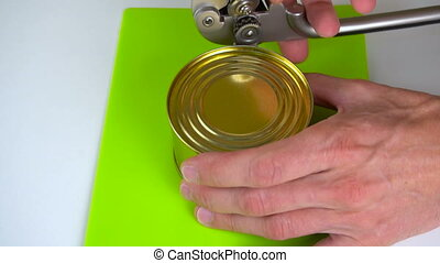 Open a jar of canned fish